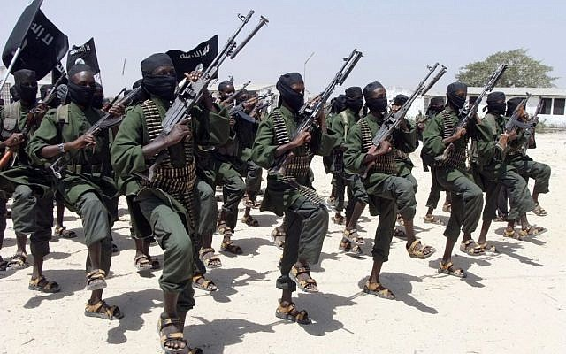 In this February 17, 2011, file photo, hundreds of newly trained Shebab fighters perform military exercises in the Lafofe area some 18 km. south of Mogadishu, Somalia. (AP/Farah Abdi Warsameh)