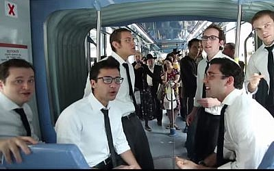 The Maccabeats sing on Jerusalem's light rail in their new video, 'Home.' (YouTube screenshot)