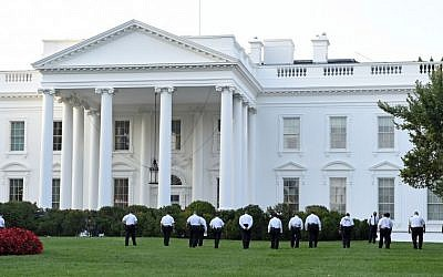 Uniformed Secret Service officers walk along the lawn on the north side of the White House in Washington, Saturday, Sept. 20, 2014. (AP/Susan Walsh)