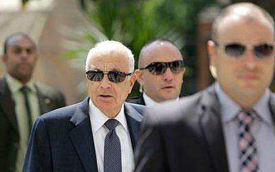 Egyptian bodyguards flank Arab League Secretary-General Nabil Elaraby, second left, upon his arrival at the league's headquarters in Cairo, Egypt, Egypt, Monday, Sept. 8, 2014 (photo credit: AP/Amr Nabil)