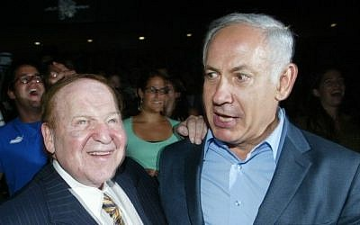 US billionaire businessman Sheldon Adelson (L) meets with Benjamin Netanyahu during a ceremony at the Congress Hall in Jerusalem, 12 August 2007. (photo credit: Flash90)
