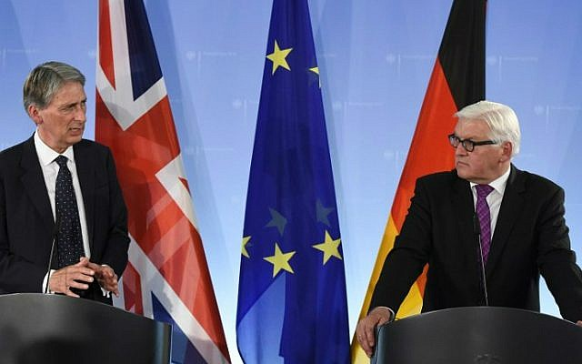 Philip Hammond and his German counterpart Foreign Minister Frank-Walter Steinmeier address a news conference after talks in Berlin on September 11, 2014. (photo credit: Tobias Schwarz/AFP)