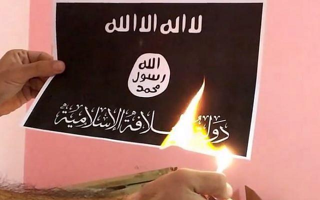 The 'Burn ISIS Flag Challenge' (photo credit: YouTube screenshot)