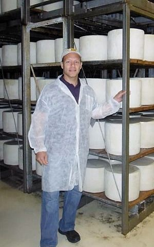 Brent Delman visiting the cheesemaking facility in Sardinia, Italy, that prepares the kosher Pecorino Romano type he sells in the United States. (Courtesy Brent Delman/JTA)