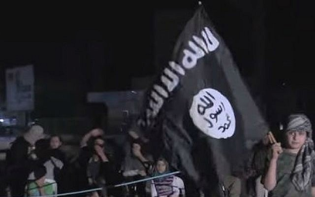 A child waves an Islamic State flag during a rally in Raqqa, Syria (photo credit: YouTube screen cap/Vice)