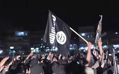 Supporters of the Islamic State wave guns and flags at a rally in Raqqa, Syria (photo credit: YouTube screen cap/Vice)
