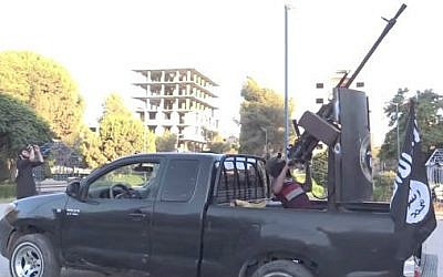 An Islamic State fighter with an anti-aircraft weapon in Raqqa, Syria (photo credit: YouTube screen cap/Vice)