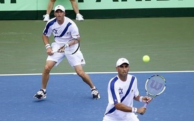 Jonathan Erlich watches as his team mate Andy Ram, of Israel, returns the ball to the team from Argentina during the Davis Cup match in Sunrise, Florida, on Saturday, September 13, 2014. (photo credit: AP/J. Pat Carter)