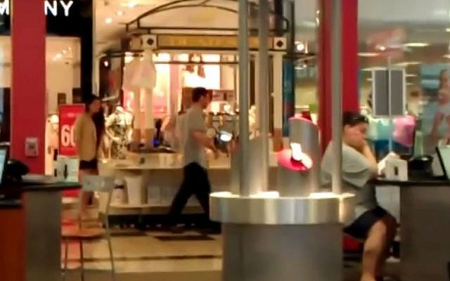 Illustrative photo of a kiosk selling Israeli beauty products at an American mall. The individuals in the photograph are not related to the content of the article. (YouTube Screenshot)