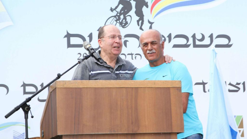 Defense Minister Moshe Ya'alon (L) at a memorial event for fallen Druze soldiers, September 12, 2014 (photo credit: Ofer Idelbici)