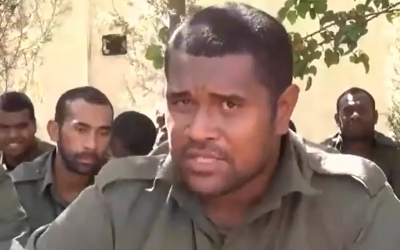 Captain Savenaca Rabuka of Fiji, flanked by fellow Fijian peacekeepers being held captive by al-Nusra Front in Syria, speaks in a video released September 10, 2014. (screen capture: YouTube/المنارة البيضاء)
