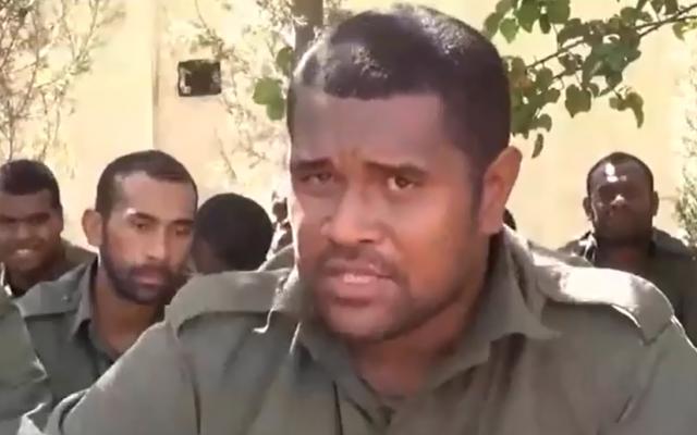 Captain Savenaca Rabuka of Fiji, flanked by fellow Fijian peacekeepers being held captive by al-Nusra Front in Syria, speaks in a video released September 10, 2014. (screen capture: YouTube/المنارة البيضاء)