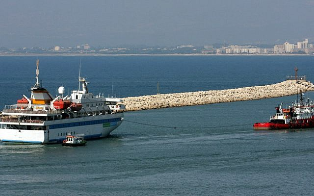 The Mavi Marmara is towed by a tugboat as it leaves the port of the northern city of Haifa, August 5, 2010. (Herzl Shapira/Flash90)