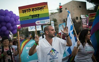 Marching along a main street in Jerusalem during the annual Gay Pride parade, on September 18, 2014. (photo credit: Hadas Parush/Flash90)