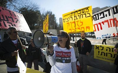 Residents of Tel Aviv's Givat Amal neighborhood protest against the court's decision to evacuate them from their homes outside the Prime Minister's Office in Jerusalem, on Sunday, February 9, 2014. Photo by Yonatan Sindel/Flash90