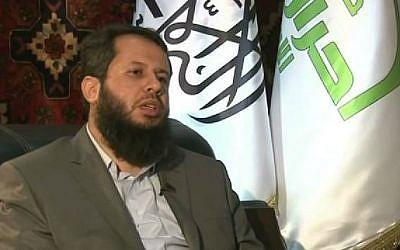 Hassan Aboud of Ahrar al-Sham during an interview with Al-Jazeera. (screen capture: YouTube/Al Jazeera English)