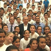 Prime Minister Benjamin Netanyahu and Education Minister Shai Piron meet with schoolchildren in southern Israel on September 1, 2014 (photo credit: Courtesy)