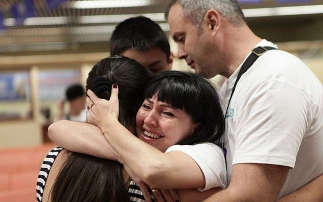 The Zheludev family is reunited at Ben-Gurion Airport upon their arrival from Ukraine September 22, 2104. (photo credit: Zed Films/Courtesy)