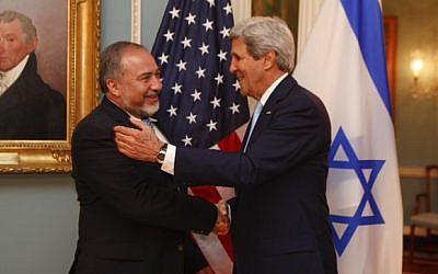Avigdor Liberman, left, and John Kerry meeting in Washington on Wednesday, September 18, 2014. photo credit: Jordan Silverman/Foreign Ministry)