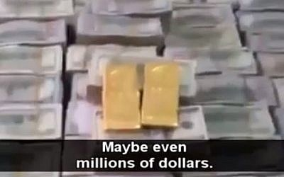 Dollars and gold allegedly captured by Islamic State from the house of Iraqi politician Osama al-Nujayfi. (photo credit: screen capture)