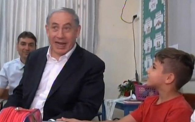 Prime Minister Benjamin Netanyahu reacts when student says he likes snakes (screen capture: Ynet)