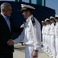 Prime Minister Benjamin Netanyahu shakes hands with members of the Israeli Navy at a ceremony welcoming the INS Tanin submarine, built by the German firm ThyssenKrupp, in the Port of Haifa on September 23, 2014. (Kobi Gideon/Government Press Office )