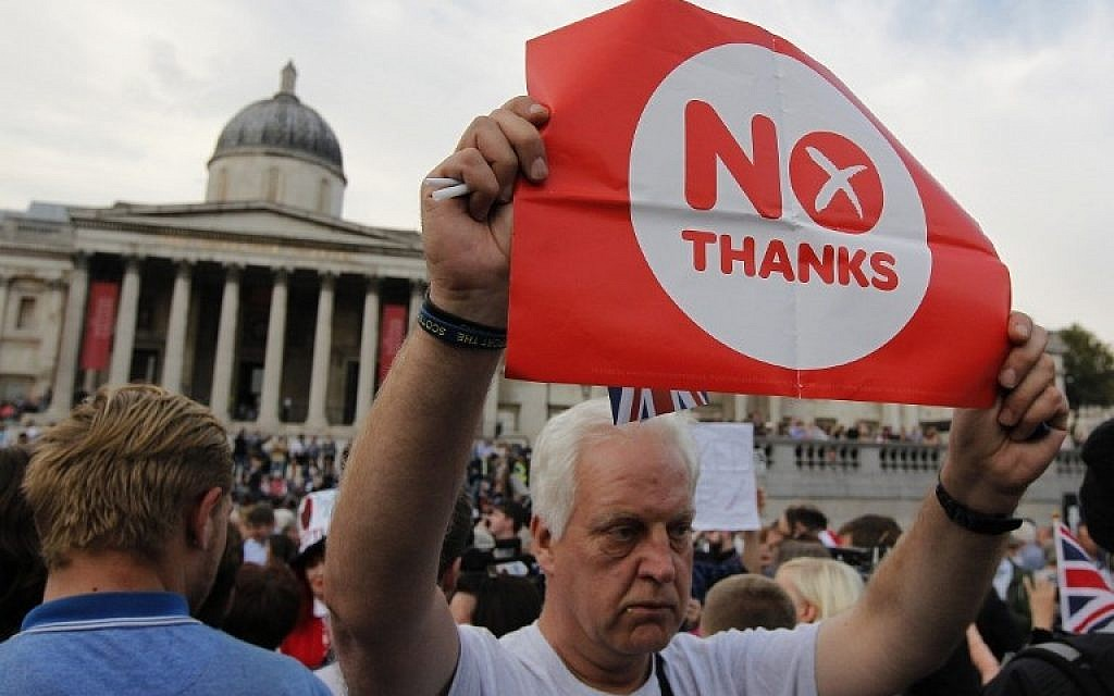 Pro-union supporters, opposing Scottish independence from the United Kingdom wave flags during a rally in Trafalgar Square in London on September 15, 2014. (photo credit: AFP PHOTO/CYRIL VILLEMAIN)