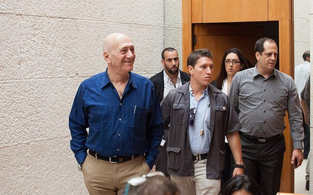 Former prime minister Ehud Olmert strides into the courtroom at the Supreme Court in Jerusalem on September 11, 2014 (photo credit: Emil Salman/Flash90)