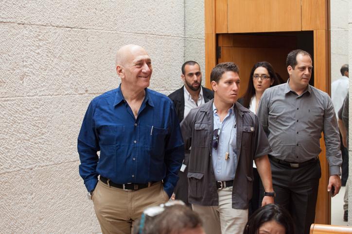 Former prime minister Ehud Olmert strides into the courtroom at the Supreme Court in Jerusalem on September 11, 2014 (photo credit: Emil Salman/Flash90)
