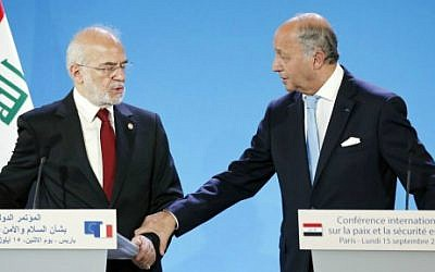 French Foreign Affairs Minister Laurent Fabius and his Iraq's counterpart Ibrahim al-Jaafari give a press conference as part of the International Conference on Peace and Security in Iraq in Paris on September 15, 2014. (photo credit: Thomas Samson/AFP)