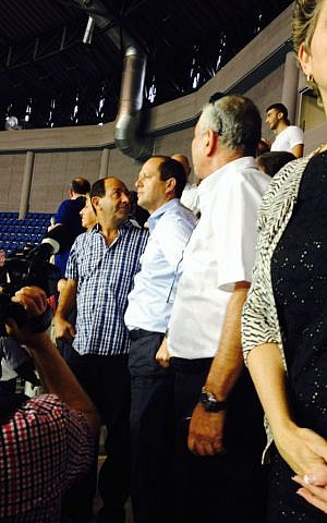 Supermarket scion Rami Levy, who is part of the mayor's Jerusalem Will Succeed faction, stands next to Mayor Nir Barkat in the new stadium (photo credit: Jessica Steinberg/Times of Israel)