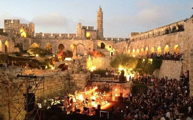 Morning breaking over the ancient walls of Jerusalem's Tower of David Museum, as Ehud Banai performed at the Sacred Music Festival (photo credit: Jessica Steinberg/Times of Israel)