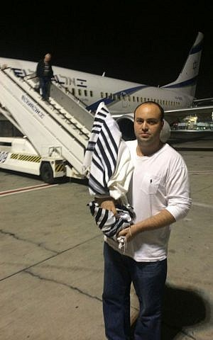 From the Depths head Jonny Daniels brings the ruined Torah scroll back to Israel for repair by Holocaust survivors. (courtesy)