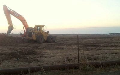A tractor on Tuesday morning at the first site where Afek hopes to begin drilling. A temporary injunction stopped work at the site on Monday night  (Courtesy photo: Adam Teva VDin)