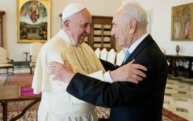 Pope Francis embraces former Israeli president Shimon Peres on September 4, 2014 prior to a private audience at the Vatican. (photo credit: AFP/Osservatore Romano)