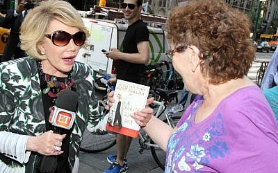 Joan Rivers talks with people on the street while promoting her new book 'Diary of a Mad Diva' on June 30, 2014 in New York City. (Photo credit: Rob Kim/Getty Images)