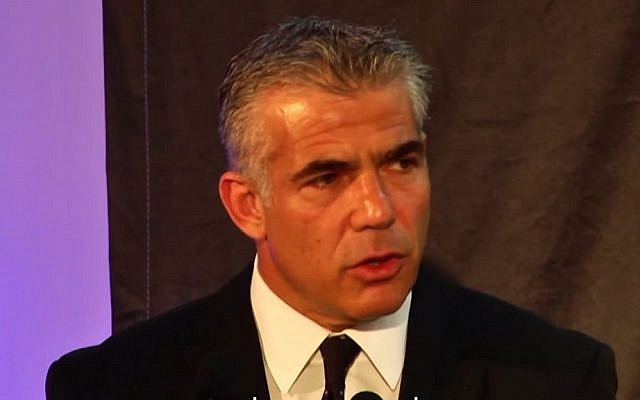Finance Minister Yair Lapid address a counter-terrorism conference in Herzliya (screen capture: YouTube)