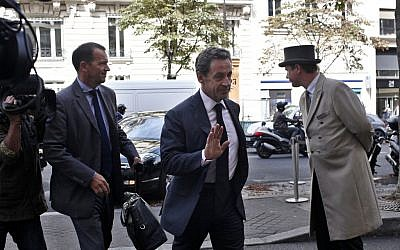 Former French President Nicolas Sarkozy arrives at a hotel in Paris, Friday, September 19, 2014. (AP Photo/Thibault Camus)
