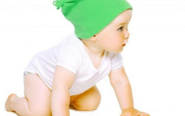 Among other things,  'winter babies' may be wearing less clothing in the summer,  when they are getting ready to crawl. (photo credit: Baby image)