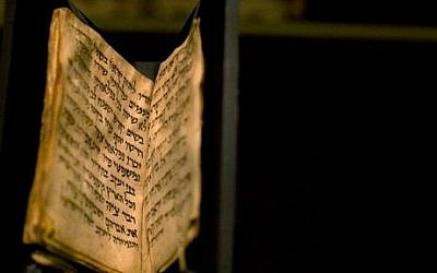 An ancient prayer book is seen on display at the Bible Lands museum in Jerusalem, Thursday, Sept. 18, 2014 (photo credit: AP/Sebastian Scheiner)