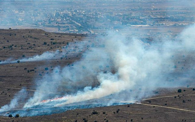 Smoke rises near Quneitra Crossing as it seen from the Golan Heights in the Israeli side on August 27, 2014 (photo credit: Flash90)