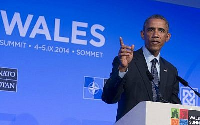 US President Barack Obama gestures during a press conference on the second day of the NATO 2014 Summit at the Celtic Manor Resort in Newport, South Wales, on September 5, 2014 (photo credit: AFP/ Saul Loeb)