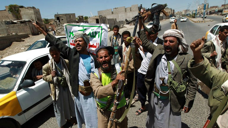 Armed Yemeni Shiite Hawthi anti-government rebels shout slogans as they man a checkpoint erected after the Hawthi group seized northern districts of the capital Sanaa on September 21, 2014 (photo credit: AFP/MOHAMMED HUWAIS)