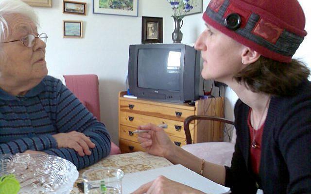 Aviv For Holocaust Survivors founder Aviva Silberman consults with a Holocaust survivor. (Courtesy)