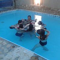 The circle of trust at water yoga in Kibbutz Lotan (photo credit: Irit Einav)