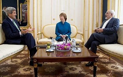 US Secretary of State John Kerry (L), European Union High Representative Catherine Ashton, and Iranian Foreign Minister Mohammad Javad Zarif are photographed as they participate in a trilateral meeting in Vienna, Austria, on October 15, 2014. (Photo credit: AFP/ POOL / CAROLYN KASTER)