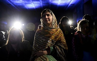 Pakistani activist for female education and Nobel Peace Prize laureate Malala Yousafzai sits before receiving the 2014 World's Children Prize for the Rights of the Child during an award ceremony at Gripsholm Castle in Stockholm on October 29, 2014.