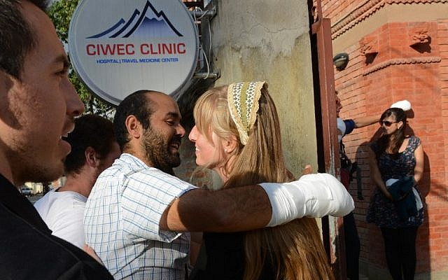 Eitan Idan, an Israeli Himalayan snowstorm survivors,  talks to compatriots after his discharge from a hospital before heading to the airport in Kathmandu on October 18, 2014. (photo credit: AFP/Prakash MATHEMA)