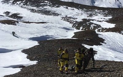Members of the Nepalese Army pulling dead bodies of trekkers from the Thorung La mountain pass on the Annapurna Circuit, in Manang District, Nepal, October 16, 2014. (photo credit: (AFP/HO/Nepalese Army)