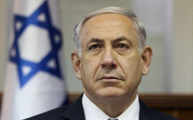Prime Minister Benjamin Netanyahu attends a cabinet meeting in Jerusalem on October 7, 2014. (photo credit: AFP PHOTO / POOL /DAN BALILTY)